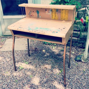 Before: A vintage industrial-style metal workbench