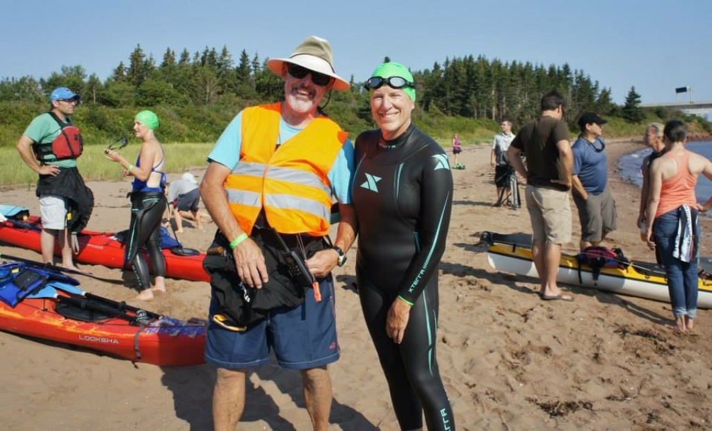 Strait swimmer Eve Burns with husband Don Dine who accompanied her in his kayak.